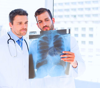 two doctors looking on the x-ray result