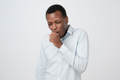 african young man coughing having flu