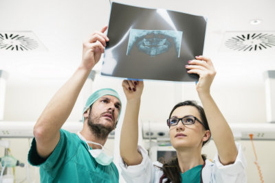 Medicine doctor showing something to her male colleague on x-ray image