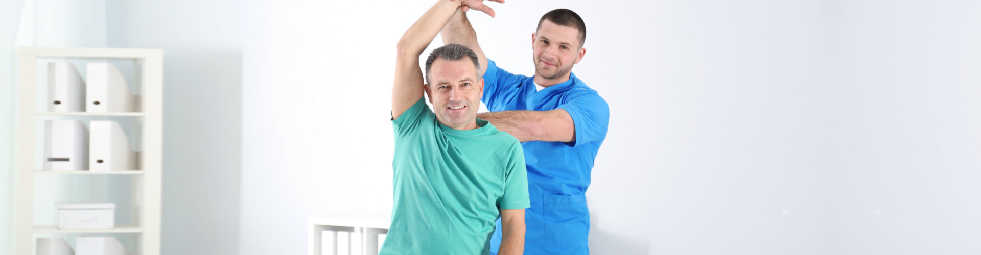therapist doing a physical therapy to the patient