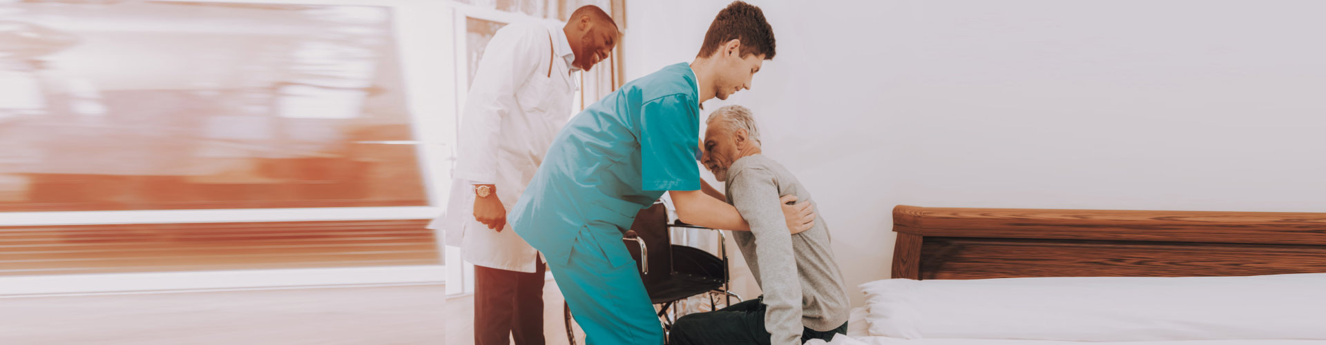 male doctor and nurse helping the old man