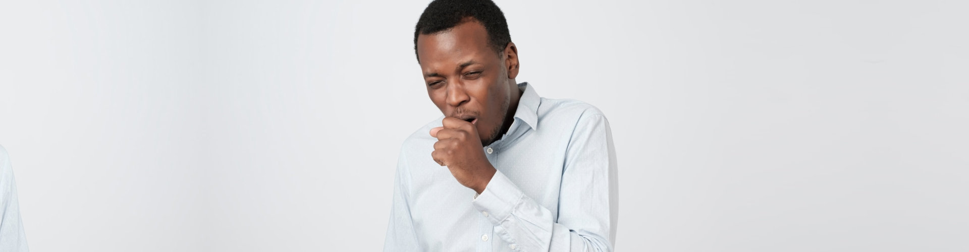 african young man coughing having flu